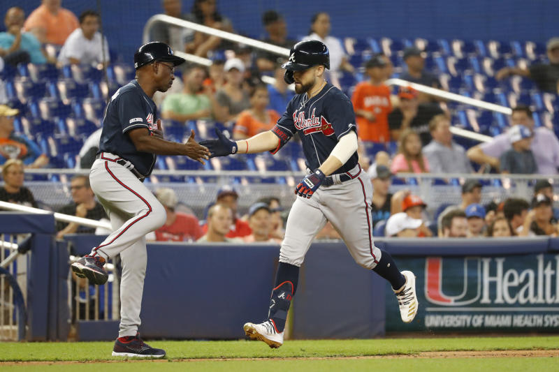 Atlanta Braves' Ender Inciarte, right, is congratulated by third base coach Ron Washington after Inciarte hit a home run during the fourth inning of a baseball game against the Miami Marlins, Sunday, Aug. 11, 2019, in Miami. (AP Photo/Wilfredo Lee)