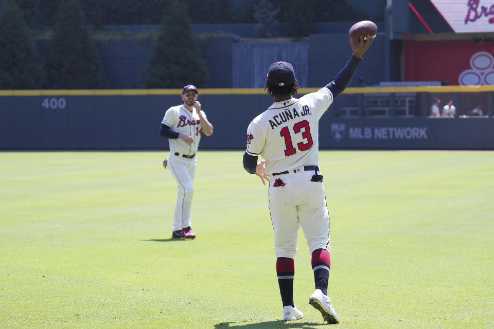 ATLANTA, GA - SEPTEMBER 08: Atlanta Braves Outfielder Ronald Acuna Jr. (l) plays around with a football prior to the MLB game between the Atlanta Braves and the Washington Nationals on September 8, 2019 at SunTrust Park in Atlanta, Georgia.  (Photo by David John Griffin/Icon Sportswire via Getty Images)