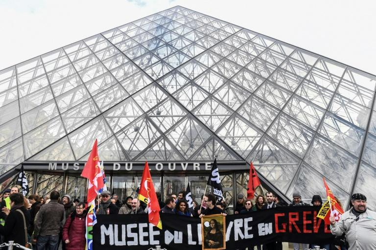 Striking workers blocked the entrance to the Louvre on Friday