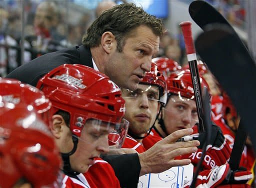 Carolina Hurricanes head coach Kirk Muller talks to his players during a time out during the first period of an NHL hockey game against the Ottawa Senators in Raleigh, N.C., Friday, Dec. 23, 2011. (AP Photo/Karl DeBlaker)