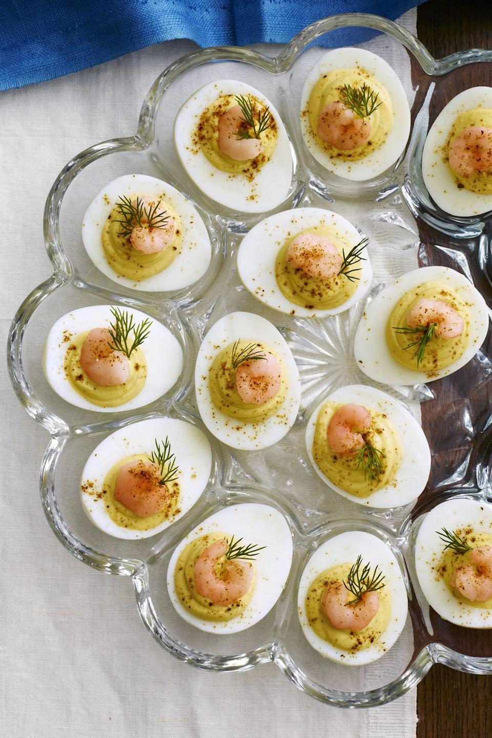 """<p>Just a dash of Old Bay seasoning gives these treats a ton of flavor. </p><p><a href=""""http://www.countryliving.com/food-drinks/recipes/a4975/deviled-eggs-old-bay-shrimp-recipe-clx0414/"""" rel=""""nofollow noopener"""" target=""""_blank"""" data-ylk=""""slk:Get the recipe."""" class=""""link rapid-noclick-resp""""><strong>Get the recipe.</strong></a></p>"""