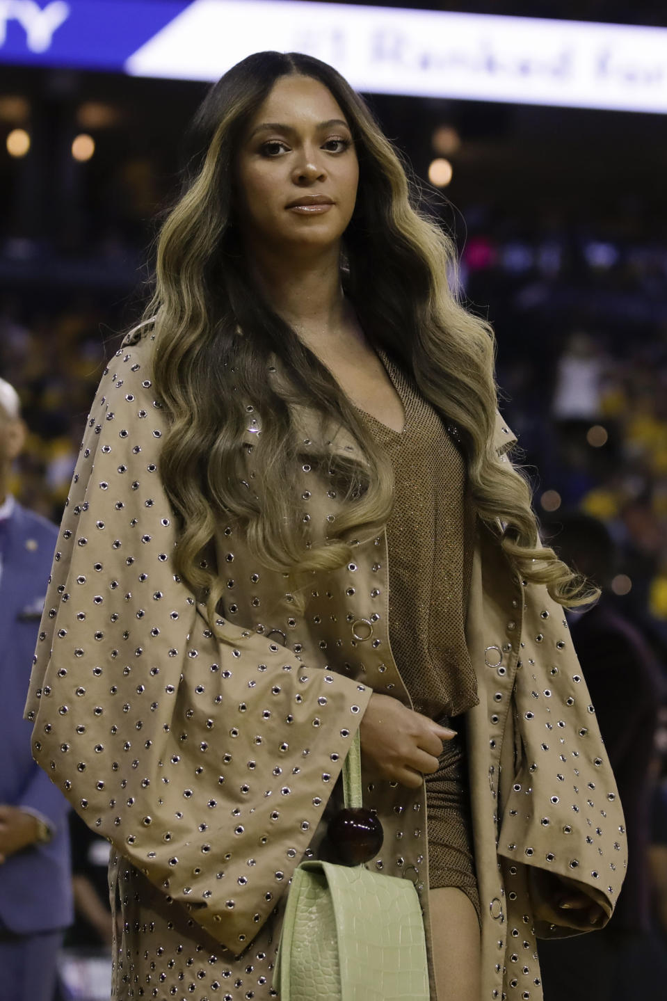 Beyonce walks to her seat during the first half of Game 3 of basketball's NBA Finals between the Golden State Warriors and the Toronto Raptors in Oakland, Calif., Wednesday, June 5, 2019. (AP Photo/Ben Margot)