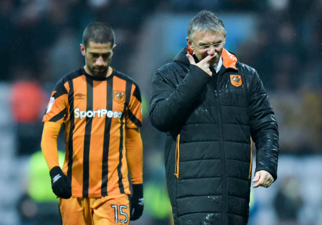 "Soccer Football - Championship - Preston North End vs Hull City - Deepdale, Preston, Britain - February 3, 2018 Hull City manager Nigel Adkins and Evandro look dejected after the final whistle Action Images/Paul Burrows EDITORIAL USE ONLY. No use with unauthorized audio, video, data, fixture lists, club/league logos or ""live"" services. Online in-match use limited to 75 images, no video emulation. No use in betting, games or single club/league/player publications. Please contact your account representative for further details."