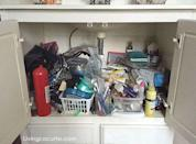 """<p>Baggies of random stuff, half-used bottles of beauty products, and even a fire extinguisher clutter up the valuable space under <a href=""""http://www.livinglocurto.com/2015/03/bathroom-organization-ideas/"""" rel=""""nofollow noopener"""" target=""""_blank"""" data-ylk=""""slk:this bathroom vanity"""" class=""""link rapid-noclick-resp"""">this bathroom vanity</a>.</p>"""