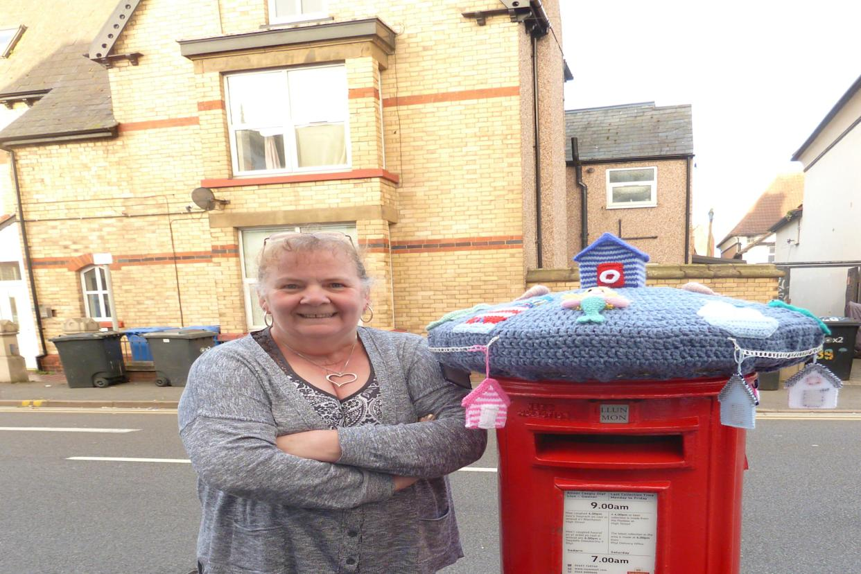 Rachel Williamson, a retired police officer, has been making postbox toppers in Rhyl, Wales, during the coronavirus pandemic