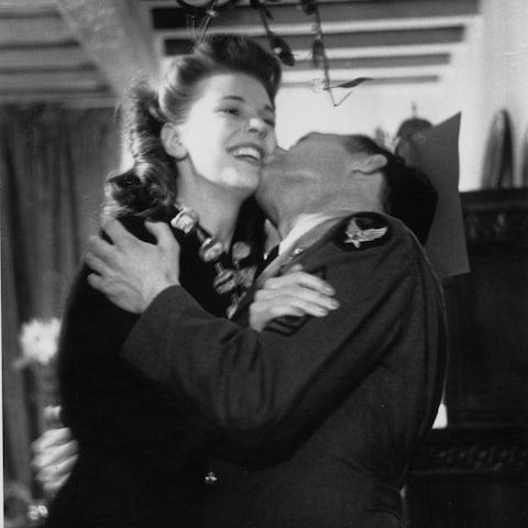 A couple kiss under the mistletoe in 1942 - Credit: Hulton Archive