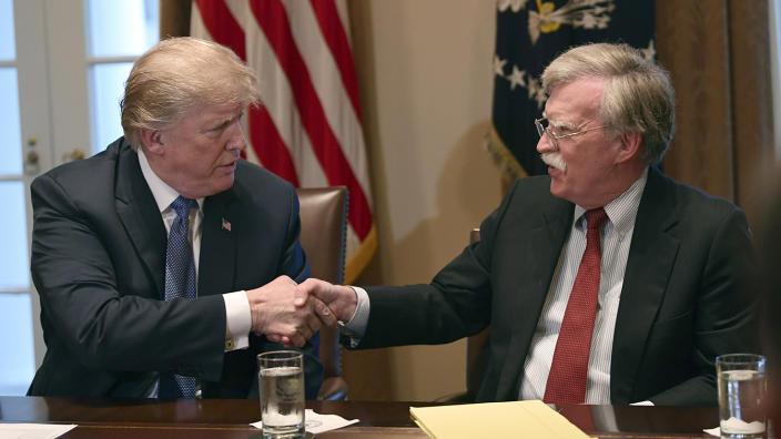 In this April 9, 2018 file photo, President Donald Trump shakes hands with national security adviser John Bolton. (AP Photo/Susan Walsh)