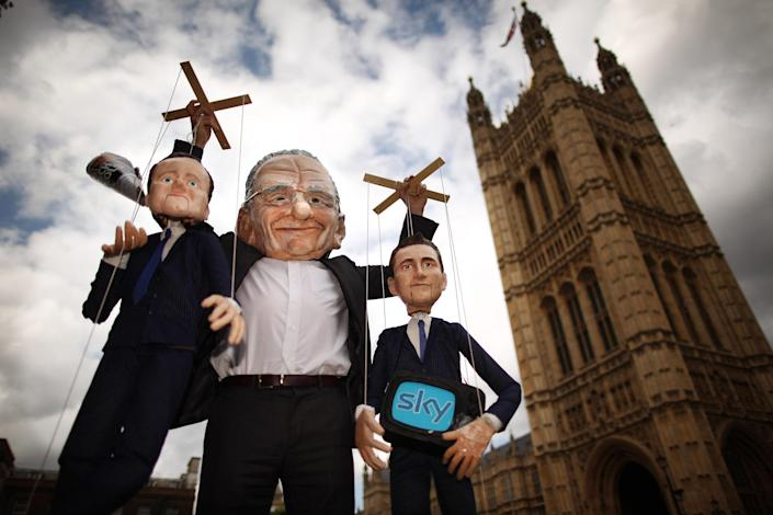 Dummies and puppets representing Prime Minister David Cameron (L) and Culture Secretary Jeremy Hunt (R) are held aloft by Rupert Murdoch at the launch of the campaign group Hacked off near Parliament on July 6, 2011 in London, England. The Prime Minister has promised that there will be a public inquiry into phone hacking carried out by journalists at The News of the World newspaper. (Photo by Peter Macdiarmid/Getty Images)