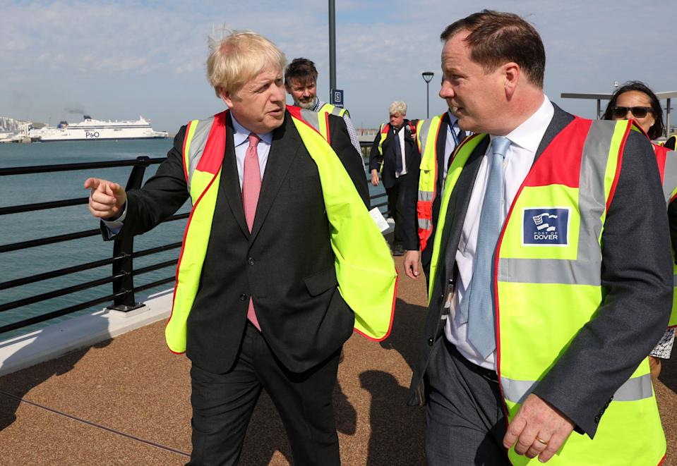Boris Johnson speaks with Dover's Conservative MP, Charlie Elphicke during a visit to the Port of Dover Ltd. (Photo by Chris Ratcliffe / POOL / AFP)