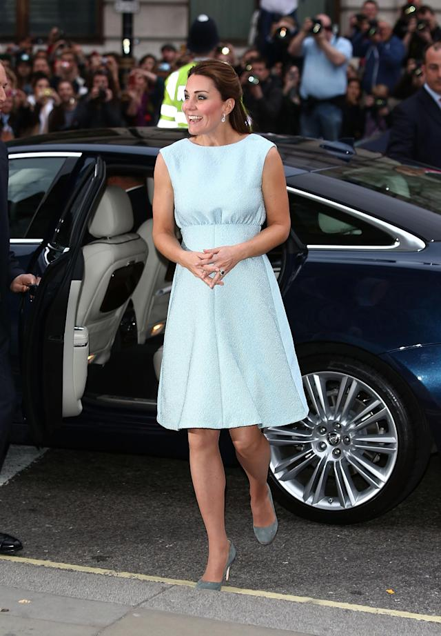 <p>For a visit to the National Portrait Gallery, the duchess chose a light blue Emilia Wickstead dress with gray suede heels. (Photo: PA) </p>