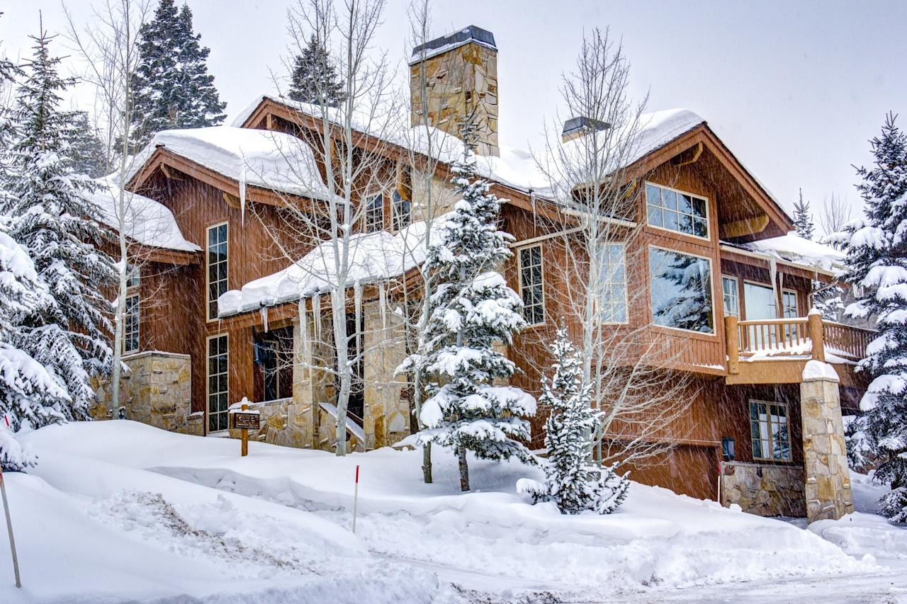 "<p>You can fit a whopping 14 guests into this ski-in, ski-out home that has direct access to <a href=""https://www.cntraveler.com/story/utah-ski-resorts-park-city-deer-valley-cottonwood-canyon-sundance?mbid=synd_yahoo_rss"" target=""_blank"">Deer Valley's</a> Silver Dollar green trail. (It has a ski prep room with boot dryers right on the trail, so you won't have to track snow or your gear any farther into the house than you need to.) And you don't have to worry about all 14 cramming into a few bunk rooms: the home is stacked with two kings, four queens, and two twin daybeds so everyone has plenty of bedcovers to hoard. You can all congregate in the enormous, open-plan living room, dining room, and kitchen with its double-height ceilings at the end of the day—or better yet, pile into the private hot tub. The home is also only about three miles from Park City's main street, making it one of the best Airbnb ski rentals for those that want a break from the slopes. </p> <p><strong>Book Now:</strong> $642 per night, <a href=""https://airbnb.pvxt.net/xP9Bx"" rel=""nofollow"" target=""_blank"">airbnb.com</a></p>"