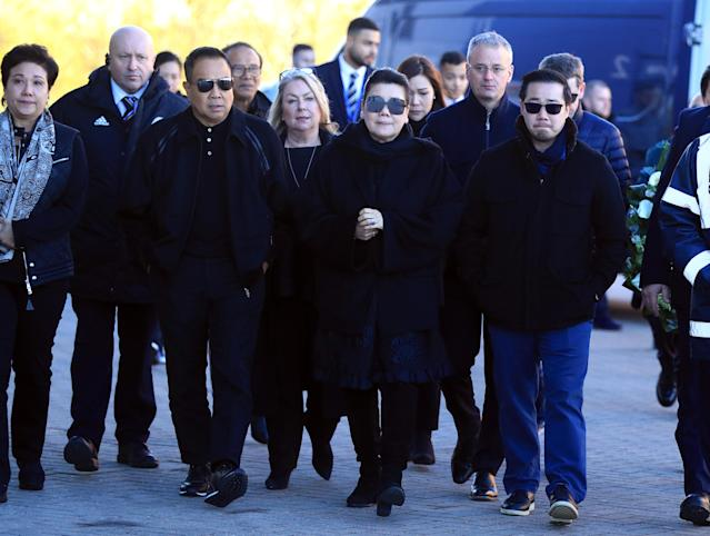<p>The Srivaddhanaprabha family pay their respects after Leicester's owner died in a helicopter crash on Saturday </p>