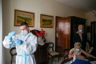 FILE PHOTO: Italy attempts to speed up vaccinations while AstraZeneca remains suspended