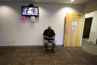 Larry Brown waits in the lobby at the Community Health Network for his occupational therapy session, Thursday, Aug. 20, 2020, in Indianapolis. The former Indiana State football player who brags about catching everything on the field now has hand therapy twice a week. (AP Photo/Darron Cummings)
