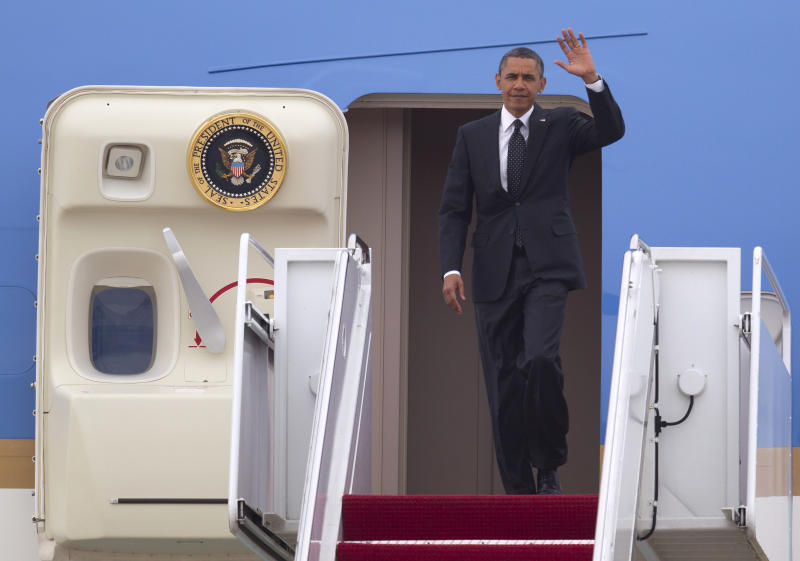 President Barack Obama waves as he steps off Air Force One at Andrews Air Force Base, Md., Wednesday, May 2, 2012, after a secret trip to Afghanistan. (AP Photo/Evan Vucci)