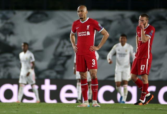 Liverpool's Fabinho and Nat Phillips look despondent after conceding a third goal to Real Madrid