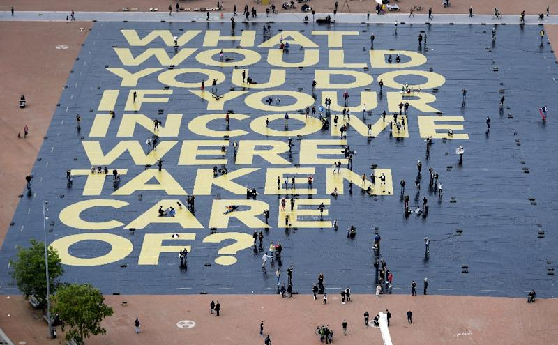 A giant poster promoting the basic income for all initiative in Switzerland was laid out in May in Plainpalais Place in Geneva