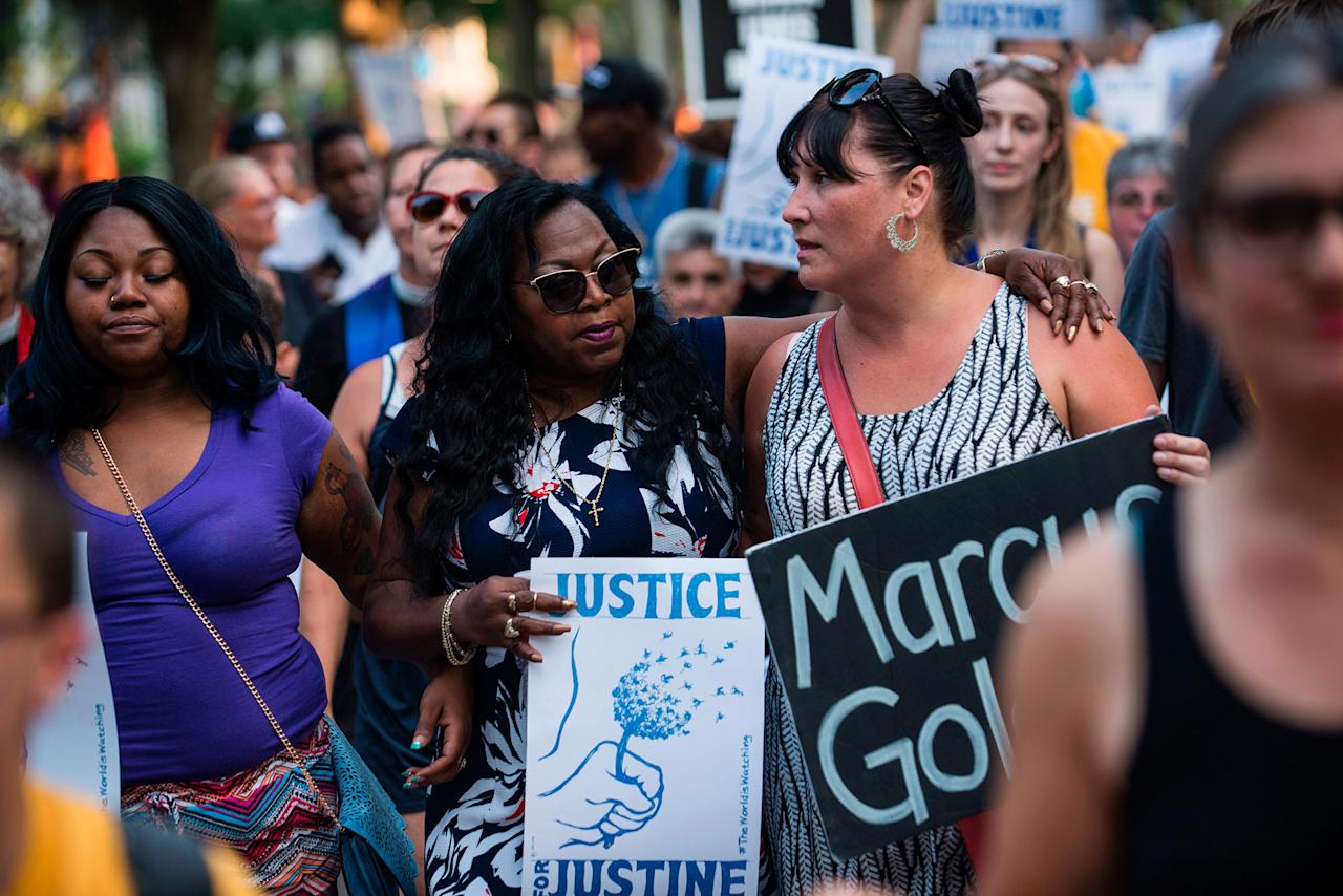 <p>Valerie Castile, center, mother of Philando Castile who was killed by a police officer last year, marches in memory of Justine Damond on July 20, 2017 in Minneapolis, Minn. (Photo: Stephen Maturen/AFP/Getty Images) </p>