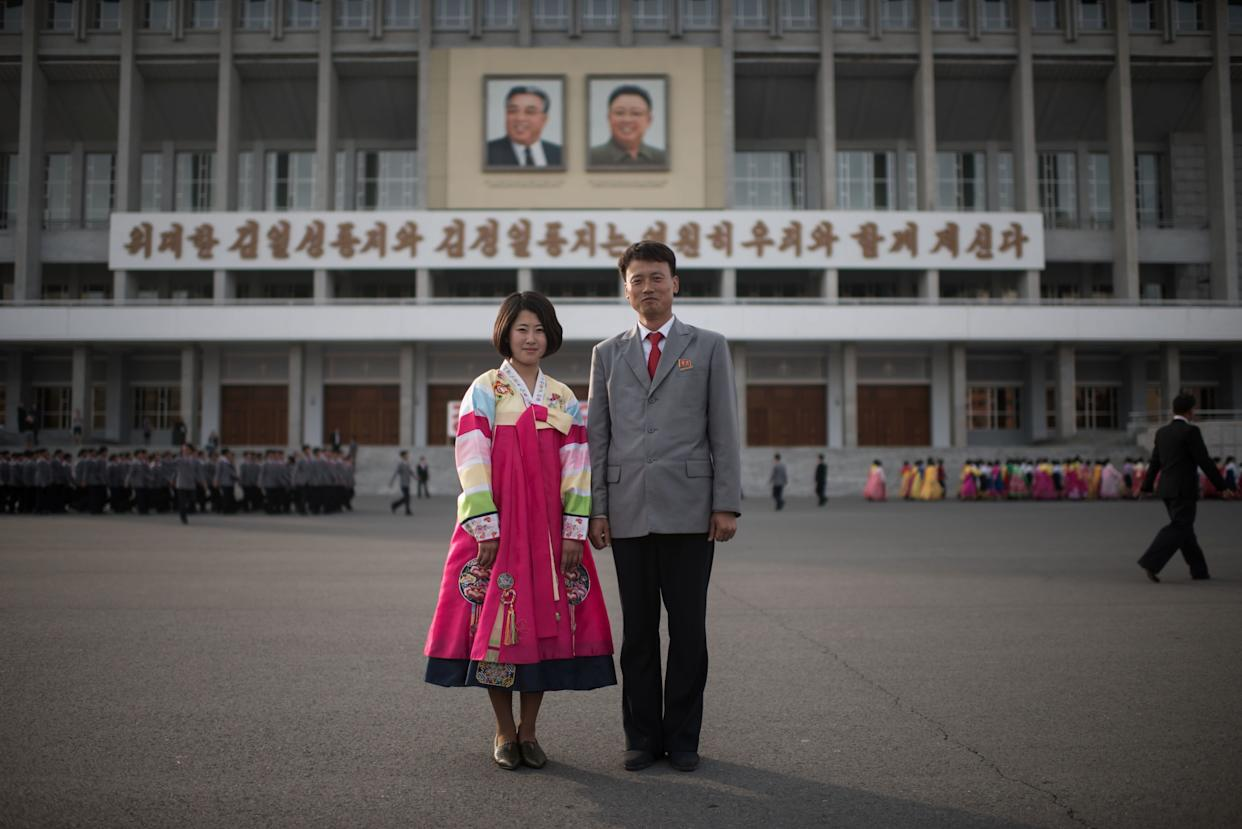Students Jo Jong-Im, 19, (left) and Jo Kwang-Hyok 31, pose for a portrait following a mass dance event in central Pyongyang.