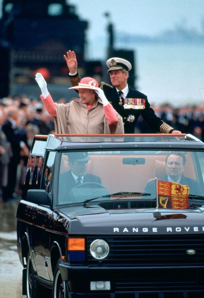 <p>Waving to crowds from their car to mark the 50th anniversary of D-Day.</p>