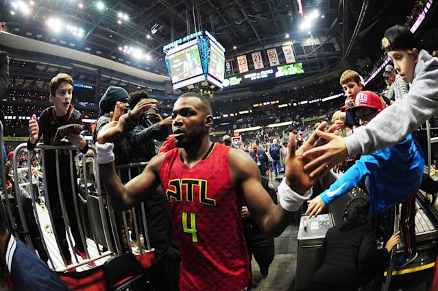 Paul Millsap seeks, and receives, some Love. (Getty Images)