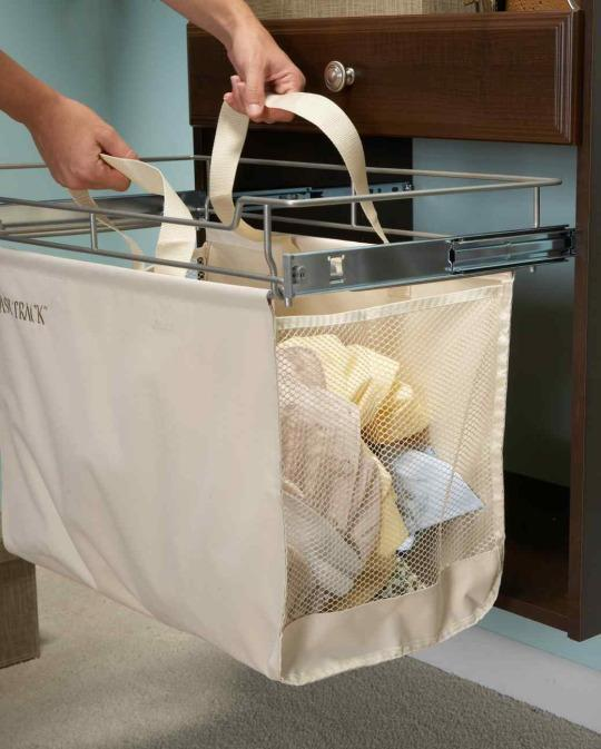 <p>This hamper tucks away neatly into your closet organizer unit, so that clothes don't pile up on the floor. When it's time for laundry day, the hamper easily lifts out of its sliding tracks.</p>