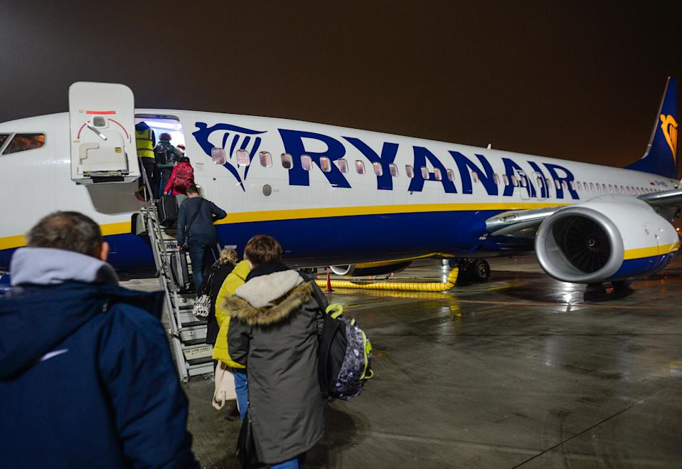 Passengers boarding a Ryanair plane to Dublin at John Paul II Krakow-Balice International Airport.  On Sunday, December 13, 2020, in Krakow-Balice International Airport, Krakow, Poland. (Photo by Artur Widak/NurPhoto via Getty Images)