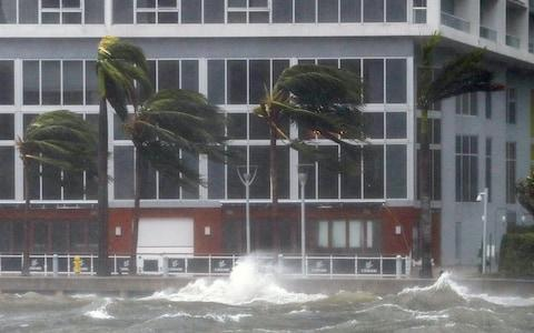 The rough waters where the Miami River meets Biscayne Bay shows the full effects of Hurricane Irma strike in Miami, Florida - Credit: ERIK S. LESSER