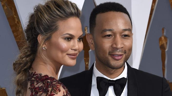 Chrissy Teigen and John Legend are seen at the 88th annual Academy Awards in February 2016.