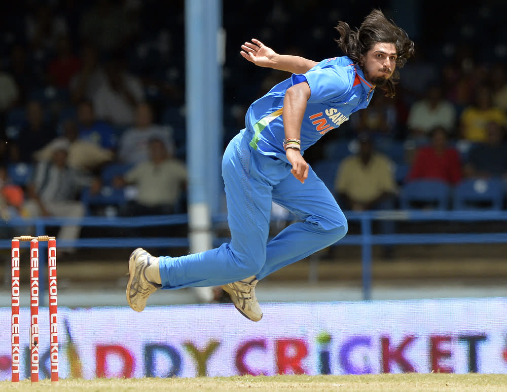 Indian cricketer Ishant Sharma looks on after a delivery during the final match of the Tri-Nation series between India and Sri Lanka at the Queen's Park Oval stadium in Port of Spain on July 11, 2013. Sri Lanka have scored 201/10. AFP PHOTO/Jewel Samad        (Photo credit should read JEWEL SAMAD/AFP/Getty Images)