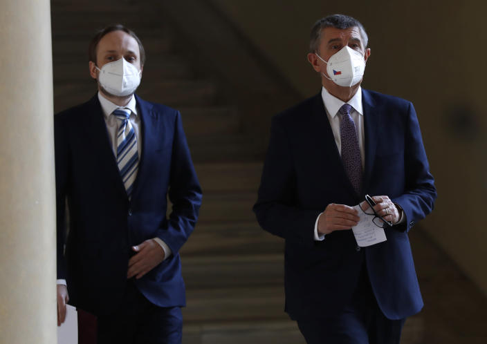 Czech Republic's Prime Minister Andrej Babis, right, and newly appointed Foreign Minister Jakub Kulhanek walk to address media at the Cernin's Palace in Prague, Czech Republic, Wednesday, April 21, 2021. Kulhanek was appointed during a Czech Russia diplomatic crisis over the alleged involvement in a fatal ammunition depot explosion in 2014. (AP Photo/Petr David Josek)