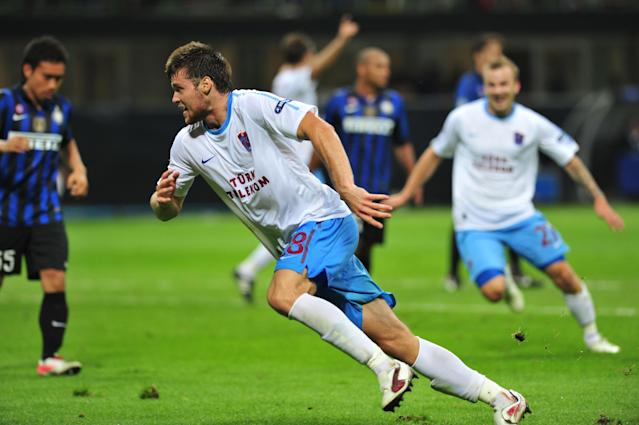 Trabzonspor's defender Ondrej Celustka (R) celebrates scoring against Inter Milan during their Champions League qualifying round match on September 14, 2011 in San Siro Stadium in Milan. Trabzonspor defeated Inter Milan 1-0. AFP PHOTO / GIUSEPPE CACACE (Photo credit should read GIUSEPPE CACACE/AFP/Getty Images)