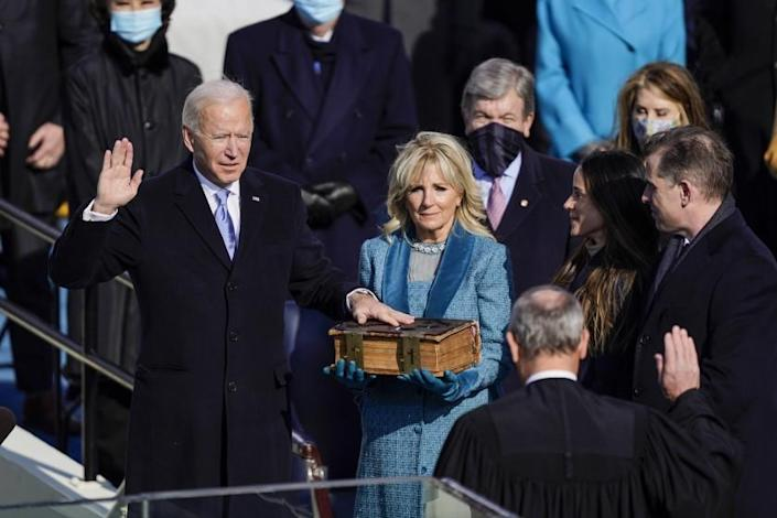 Washington , DC - January 20: U.S. President-elect Joe Biden takes the oath of office from Supreme Court Chief Justice John Roberts as his wife U.S. First Lady-elect Jill Biden stands next to him during the 59th presidential inauguration in Washington, D.C. on Wednesday, Jan. 20, 2021. . (Kent Nishimura / Los Angeles Times)