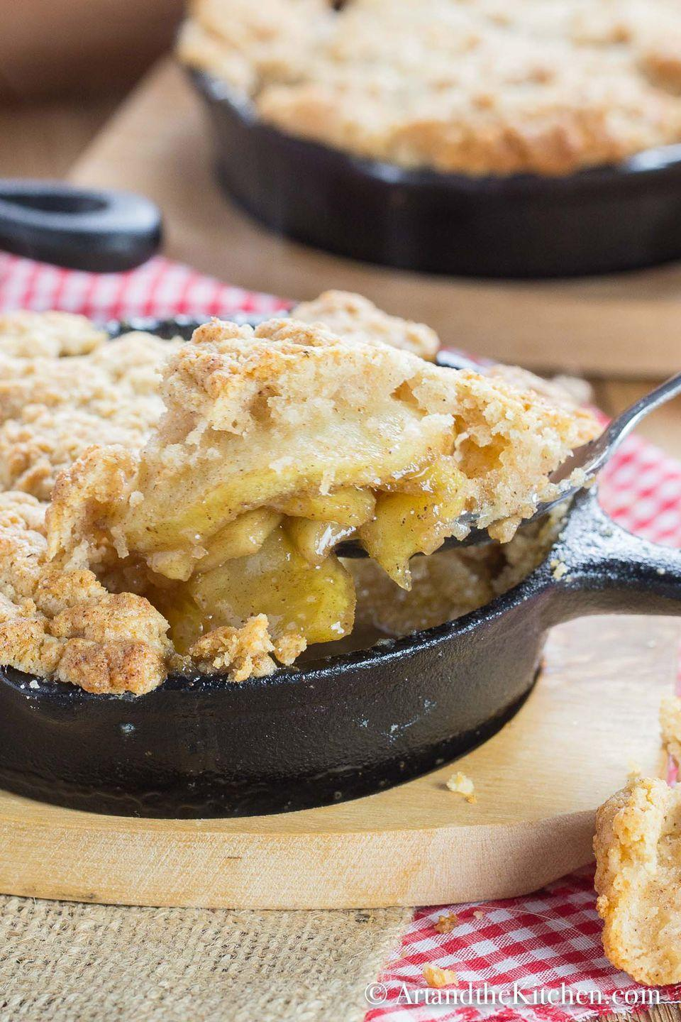 """<p>There's nothing like a classic apple cobbler with a warm filling and flaky biscuit crust. You can make this recipe in individual servings, too, so everyone gets their own cobbler.</p><p><strong>Get the recipe at Art and <a rel=""""nofollow noopener"""" href=""""https://www.artandthekitchen.com/apple-cobbler/"""" target=""""_blank"""" data-ylk=""""slk:The Kitchen"""" class=""""link rapid-noclick-resp"""">The Kitchen</a>.</strong><br></p><p><a rel=""""nofollow noopener"""" href=""""https://www.amazon.com/Lodge-LMS3-Miniature-Skillet-3-5-inch/dp/B00OBUW4TU"""" target=""""_blank"""" data-ylk=""""slk:SHOP CAST IRON SKILLETS"""" class=""""link rapid-noclick-resp"""">SHOP CAST IRON SKILLETS</a></p>"""