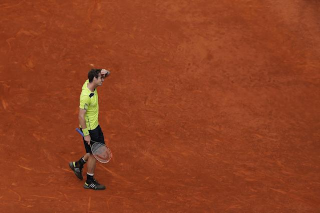 Andy Murray from Britain reacts during a Madrid Open tennis tournament match against Santiago Giraldo from Colombia in Madrid, Spain, Thursday, May 8, 2014. (AP Photo/Andres Kudacki)