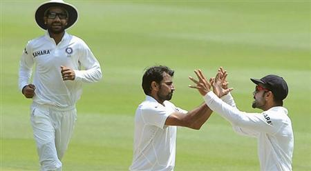 Mohammed Shami (C) celebrates with teammates after bowling out South Africa's Alviro Petersen during the final day of their cricket test match in Johannesburg, December 22, 2013. REUTERS/Ihsaan Haffejee