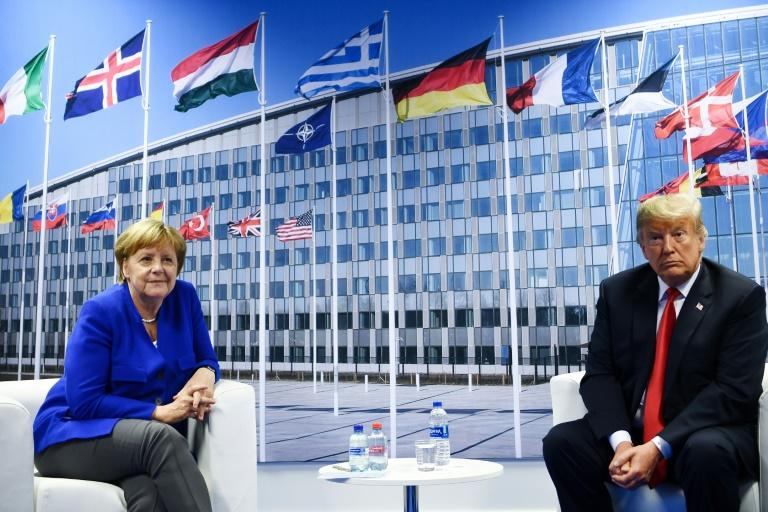 Relations between US President Donald Trump (R) and German Chancellor Angela Merkel have been strained at the NATO summit