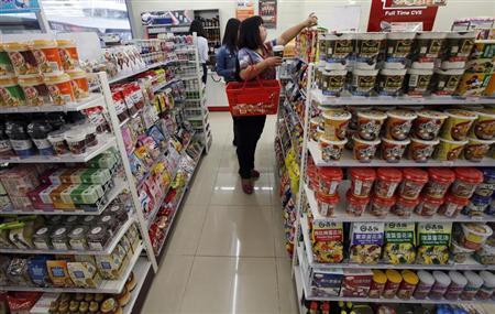 Customers choose goods at a shop in Beijing