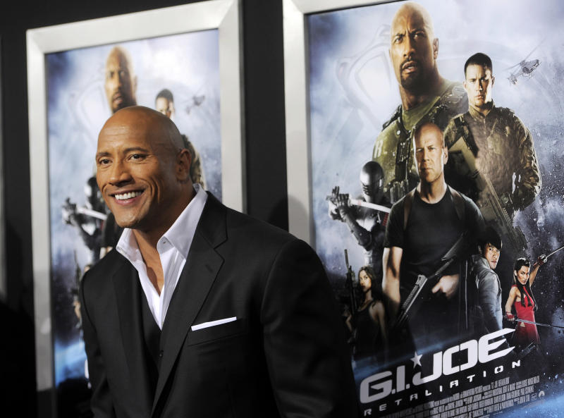 "Dwayne Johnson, a cast member in ""G.I. Joe: Retaliation,"" poses at the Los Angeles premiere of the film at the TCL Chinese Theatre on Thursday, March 28, 2013 in Los Angeles. (Photo by Chris Pizzello/Invision/AP)"