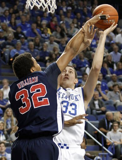 Kentucky's Kyle Wiltjer (33) shoots under pressure from Samford's Tim Williams during the first half of an NCAA college basketball game at Rupp Arena in Lexington, Ky., Tuesday, Dec. 4, 2012. (AP Photo/James Crisp)