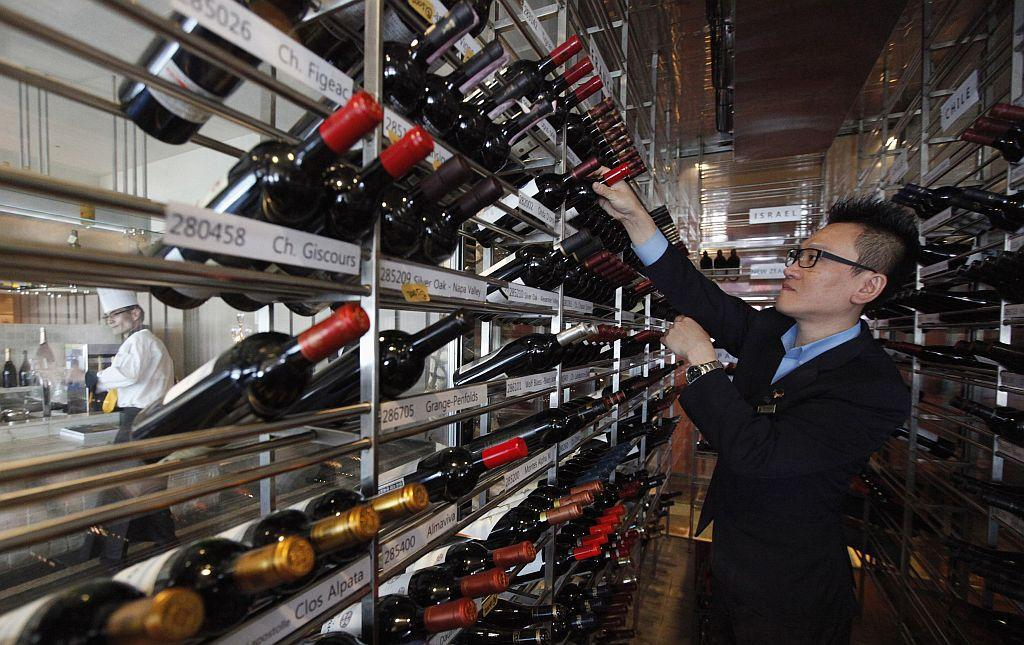 A manager looks at wines at the Marco Polo restaurant at the Grand Intercontinental Hotel in the Gangnam area of Seoul.