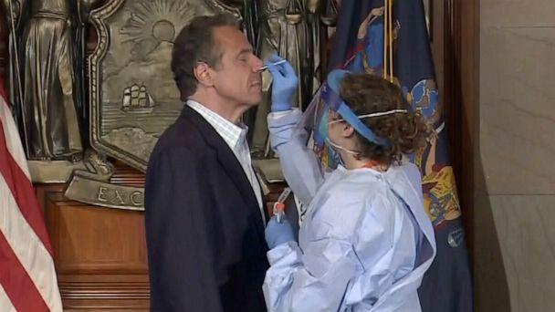 PHOTO: New York Gov. Andrew Cuomo receives a COVID-19 swab test during his daily briefing, May 17, 2020, in Albany, New York. (Pool via ABC News)