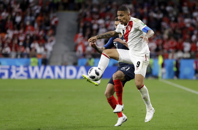 Peru's Paolo Guerrero is challenged by France's Lucas Hernandez, rear, during the group C match between France and Peru at the 2018 soccer World Cup in the Yekaterinburg Arena in Yekaterinburg, Russia, Thursday, June 21, 2018. (AP Photo/Natacha Pisarenko)