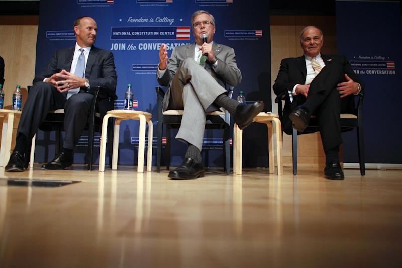 Interim chairman Doug DeVos, left, and former Gov. Ed Rendell, right, listen as former Florida Gov. Jeb Bush, center, speaks during a news conference, Thursday Dec. 6, 2012, in Philadelphia, where it was announced Bush will follow Bill Clinton as chairman of the National Constitution Center. (AP Photo/ Joseph Kaczmarek)