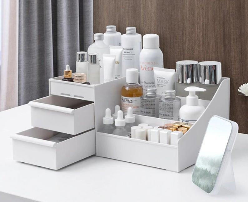 "<h3>Lightning Store Art Cosmetic Organizer</h3><strong>The Storage Box Organizer</strong><br><br>Keep your daily favorites displayed in this sleek white set that can house everything from your toners to lipsticks.<br><br><strong>The Hype: </strong>4.9 out of 5 stars and 69 reviews on <a href=""https://www.etsy.com/listing/803804045/makeup-organizer-desk-organizer-makeup"" rel=""nofollow noopener"" target=""_blank"" data-ylk=""slk:Etsy"" class=""link rapid-noclick-resp"">Etsy</a><br><br><strong>Organization Obsessives Say: </strong>""You never realize how much time this organizer saves you until you actually purchase one. The blue is gorgeous but I ultimately decided to go with the white one. It's a great size and definitely organized my bathroom a lot better."" — Alexis, Etsy Reviewer<br><br><strong>LightningStoreArt</strong> Cosmetic Storage Box Organizer, $, available at <a href=""https://go.skimresources.com/?id=30283X879131&url=https%3A%2F%2Fwww.etsy.com%2Flisting%2F964668017%2Fcosmetic-storage-box-organizer-desktop%3Fga_order%3Dmost_relevant%26ga_search_type%3Dall%26ga_view_type%3Dgallery%26ga_search_query%3DMakeup%2B%2526%2BDesk%2BOrganizer%26ref%3Dsr_gallery-1-8%26organic_search_click%3D1%26frs%3D1"" rel=""nofollow noopener"" target=""_blank"" data-ylk=""slk:Etsy"" class=""link rapid-noclick-resp"">Etsy</a>"