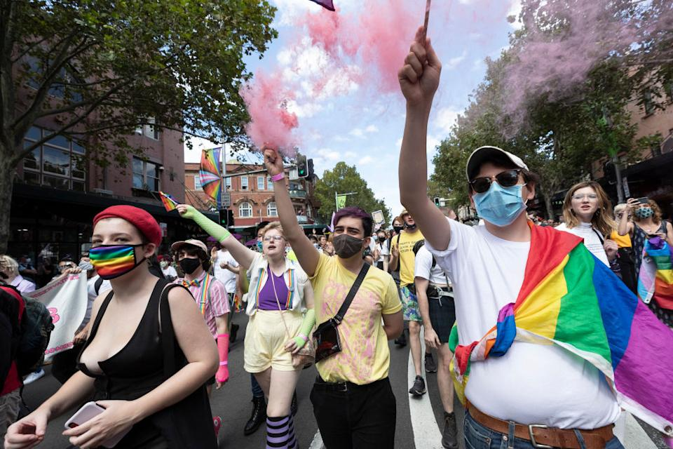 Protesters march in support of LGBTQI rights on Oxford Street in Sydney.