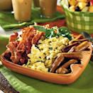 """<p>Serve scrambled <a href=""""https://www.myrecipes.com/egg-recipes/"""" rel=""""nofollow noopener"""" target=""""_blank"""" data-ylk=""""slk:eggs"""" class=""""link rapid-noclick-resp"""">eggs</a> with cream cheese for a delicious twist on this traditional breakfast dish. Chopped <a href=""""https://www.myrecipes.com/how-to/7-ways-with/recipes-using-fresh-basil"""" rel=""""nofollow noopener"""" target=""""_blank"""" data-ylk=""""slk:fresh basil"""" class=""""link rapid-noclick-resp"""">fresh basil</a> adds an aromatic note as well.</p>"""