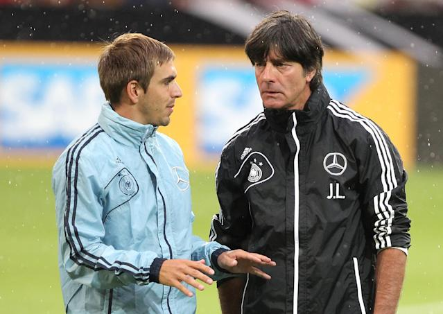 File photo of Germany's coach Joachim Loew (R) talking with Philipp Lahm during a public training session in Germany (AFP Photo/Daniel Roland)