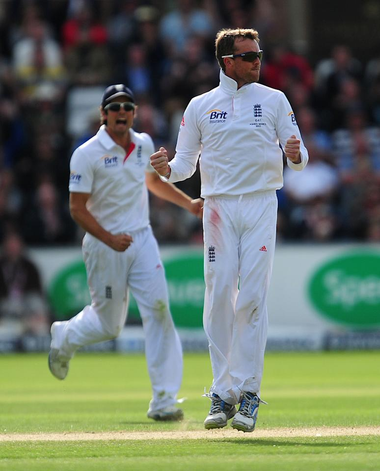 England's Graeme Swann celebrates taking the wicket of Australia's Usman Khawaja during day four of the Fourth Investec Ashes test match at the Emirates Durham ICG, Durham.