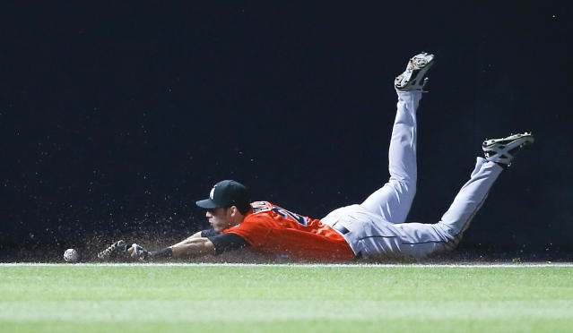 Miami Marlins left fielder Christian Yelich (21) can't reach a ball hit for a double by Atlanta Braves pinch hitter Jordan Schafer in the ninth inning of a baseball game Monday, April 21, 2014 in Atlanta. Atlanta won 4-2 in the tens innings. (AP Photo/John Bazemore)